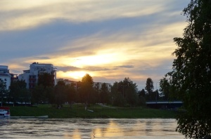 The sun at midnight on the banks of the Kemioki River, Rovaniemi